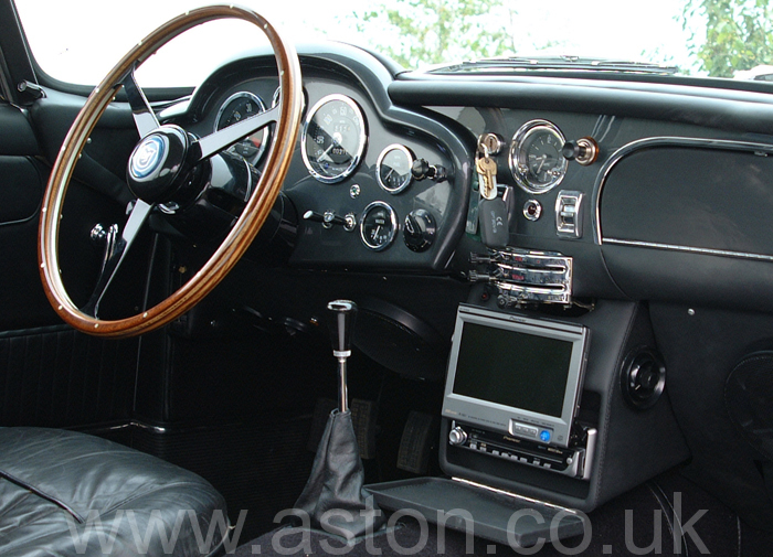 A combined navigation and audio system installed in the central console. When not in use, this folds away to leave it looking as the original.